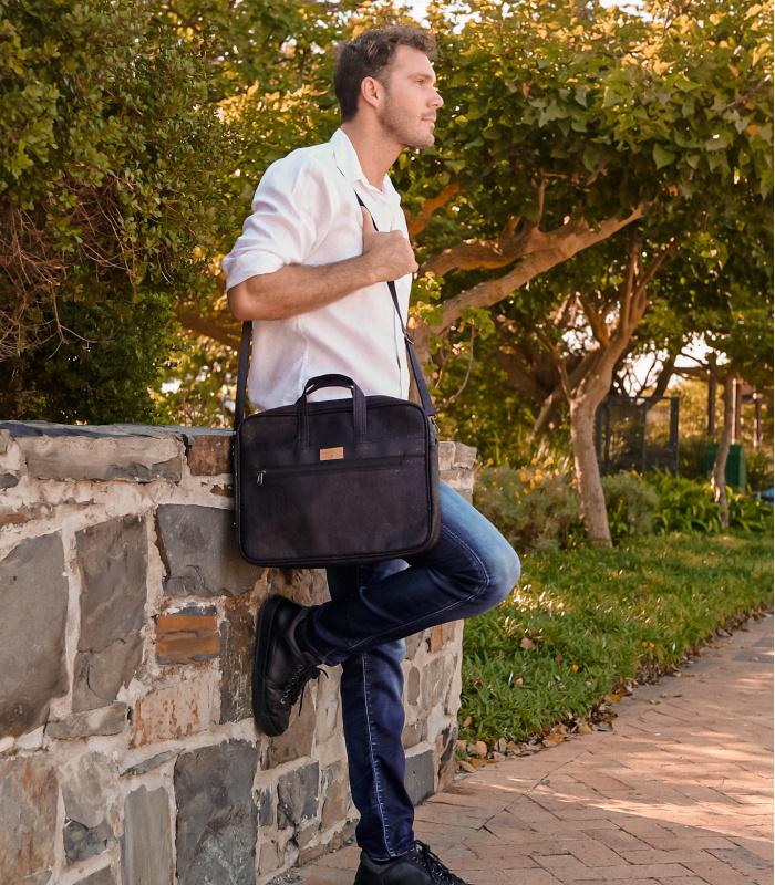 Black laptop bag made from cork. Vegan Laptop bag made from natural cork.